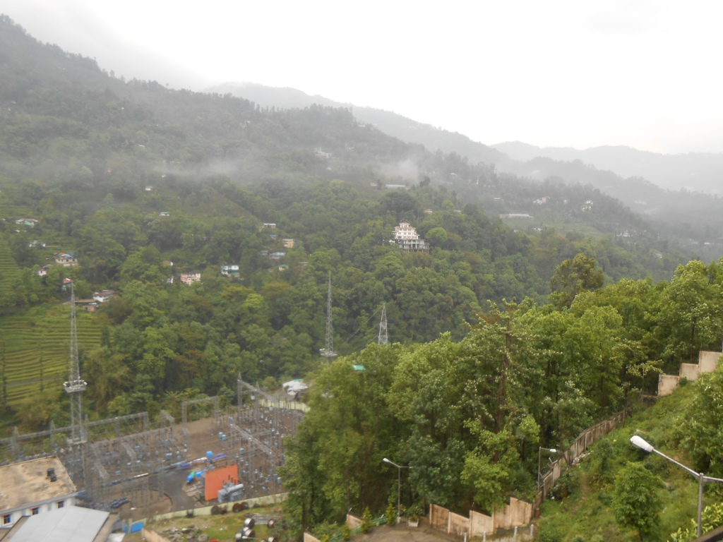 View from the Guest house: the village of Assam Lynchok and the Power grid Substation