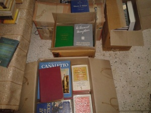 packing up books while helping parents move in to their new place